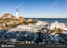 portland head light lighthouse portland head light lighthouse early morning waves crashing rocky