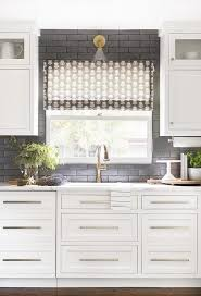 what tile goes with white cabinets white cabinets on black backsplash transitional kitchen