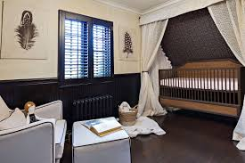 contemporary tudor nursery with stars and feathers lauren levant