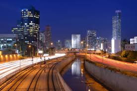 tel aviv city lights up at night from the grapevine