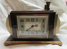 impressive figural deco ronson touch ronson touch tip table lighter clock exactly like the one in the