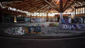 abandoned indoor pool complex graffiti on the walls stock video