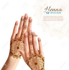 women hands coloring with indian henna paste or mehndi design