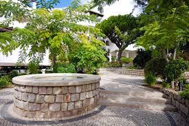 beautiful fountain in scenic cobblestone patio algarve portuga