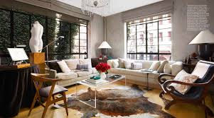 comfy gray sofa shiny glass swivel base orange tulips in white
