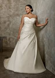 embroidered lace appliques on tulle ball gown with scalloped