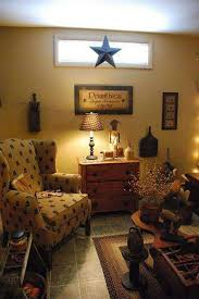 primitive living room with wingback chair and dresser and wooden
