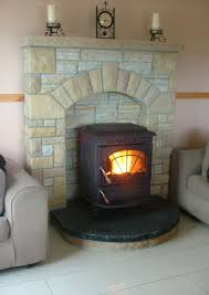 gold quartzite u0026 sandstone fireplace surround with a black