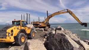 big volvo cat 375b long reach excavator and volvo l220h wheelloader moving
