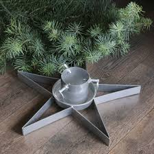 silver cast iron tree stand by ella