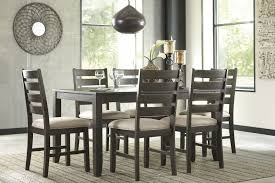 signature design by ashley rokane brown 7 piece dining room table signature design d397 425 1