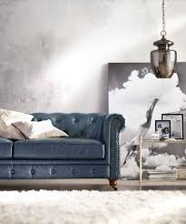 got to love a blue leather sofa pair it with a soft white rug and