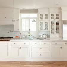 White Glass Backsplash Design Ideas - Long kitchen cabinets