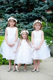 flower dresses and ring bearer photos inside weddings