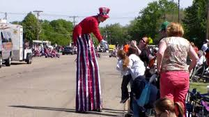 clown stilts clown on skateboard and woman on high stilts among attractions at