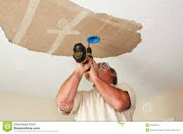 Replacing A Ceiling Light Fixture Electrician Installing Light Fixture On Ceiling Stock Photo
