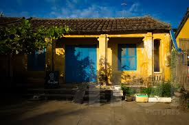 frontage of an old french colonial style house in hoi an vietnam