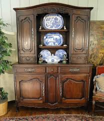 antique french hutch and bookcase with carved scalloped oak