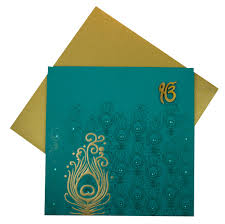 sikh wedding cards wedding cards in turquoise blue with peacock design