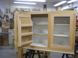 hand made red oak kitchen cabinet with interior spice rack by