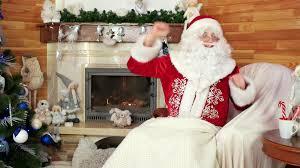 santa papa noel sitting in chair at winter