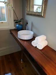 custom timber vanity made from a solid jarrah slab