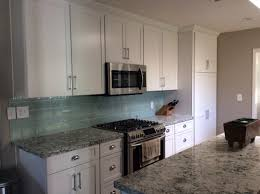 cambria praa sands white shaker diamond cabinets tilebar sea