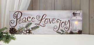 peace love joy on worn white background