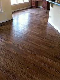 minwax color guide stain samples on a white oak floor from top