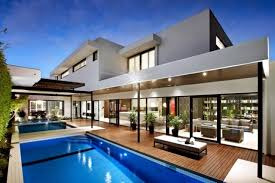house with pool modern house with pool surrounded by a spacious deck wood interior