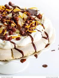 pavlova with pears hazelnuts orange and chocolate dessert