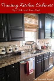 Black Cabinet Kitchens black cabinets with faux distressing used 3 different colors of