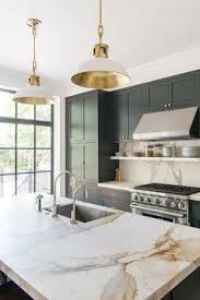 Kitchen Cabinets With Lights by Hunter Green Kitchen Cabinets With A Brass Sink Faucet Pendant
