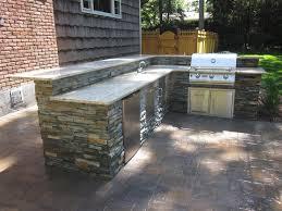 outdoor kitchen backsplash outdoor kitchen with raised bar veneered with east west