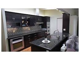 great room double ovens gray walls white countertops cabinets