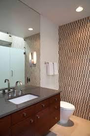 accent wallpaper grey vanity top and beige floor in the powder room