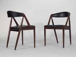 world market arcadia table round back dining chairs mid century kai kristiansen curved 45 7