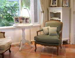 Leafy Green Bergere Against Terracotta Tiles Creates A Quaint Area - Interior design french provincial style
