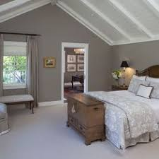 smart design of an attic bedroom wainscoting halfway up the wall