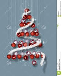 tree made of ornaments on blue background stock photo