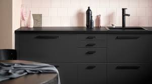 recycled pet bottles become ikea kitchen cabinetry fronts swedish furniture giant ikea s new line of kitchen cabinets is made from reclaimed wood planks and laminate coating made from recycled pet bottles