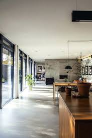 white kitchen and dining room with wooden table concrete
