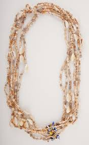eye charm necklace images Wanderlista fiji shell necklace with evil eye charm wanderlista jpg