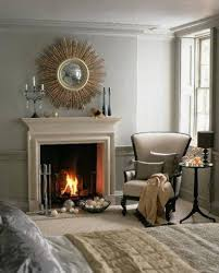 decoration sunburst mirror above bedroom fireplace single