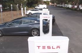 how tesla may charge model 3 owners for supercharger access