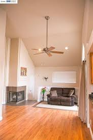 contemporary living room with ceiling fan carpet in dublin ca
