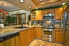 Black Appliances Kitchen Design - oak kitchen cabinets with black appliances quartz countertops