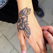 black and white flower tattoo on left hand