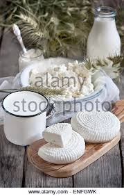 Goat Cottage Cheese by Milk Cottage Cheese Wheat And Oat Grains On Old Wooden