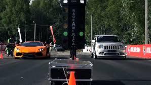 racing jeep cherokee stock aventador races 950 hp jeep grand cherokee srt 8 autoevolution